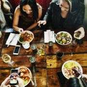 sharing-lunch-in-restaurant-928010348-5b4abe8f46e0fb003712c478