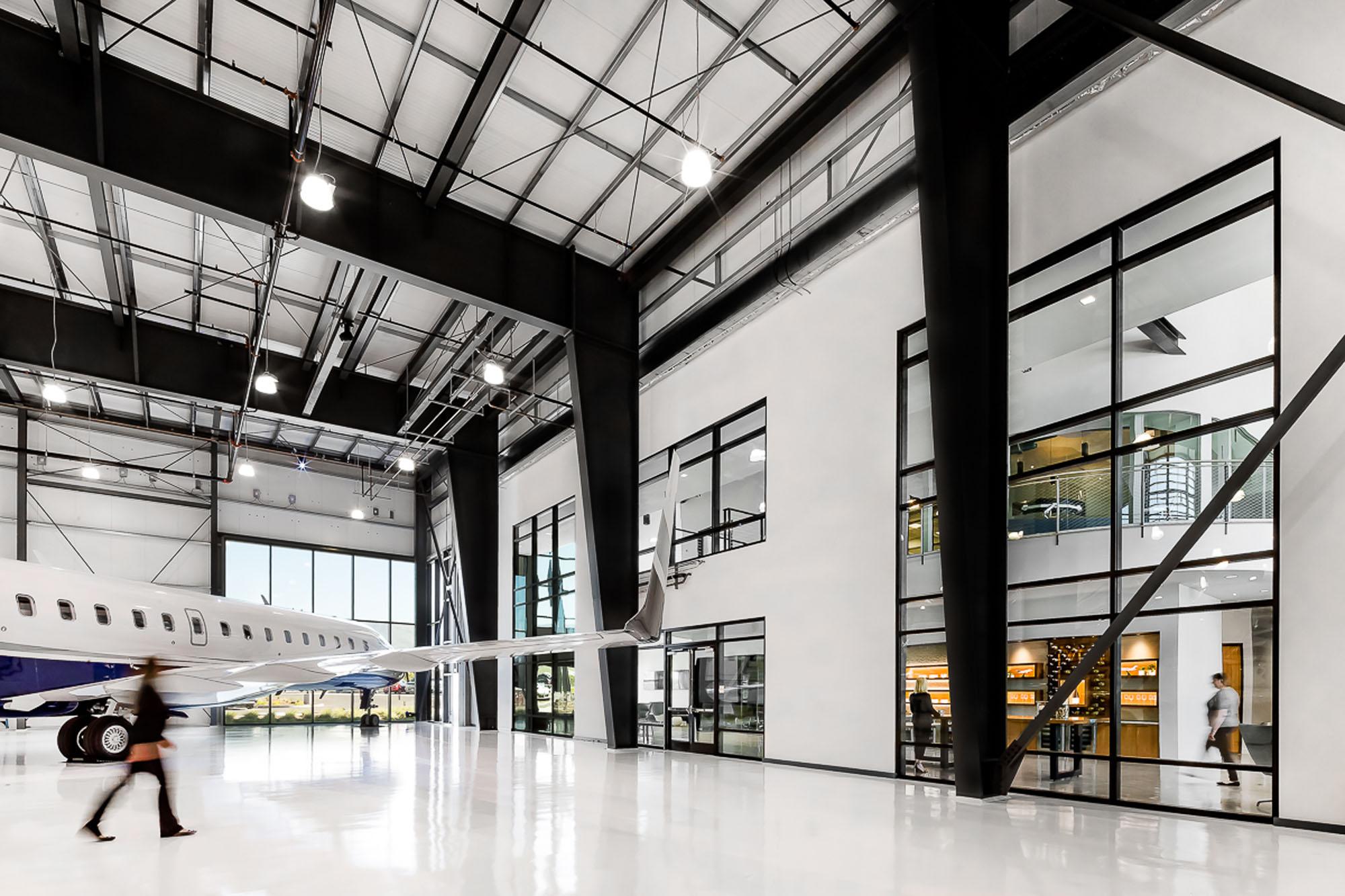 Dexigner: NELSON Worldwide Completes ACI Jet Hangar and Office